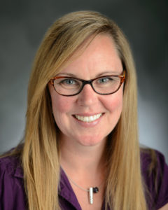 Kimberly Fenn, assistant professor of psychology, poses in the studio on Thursday June 12, 2014.