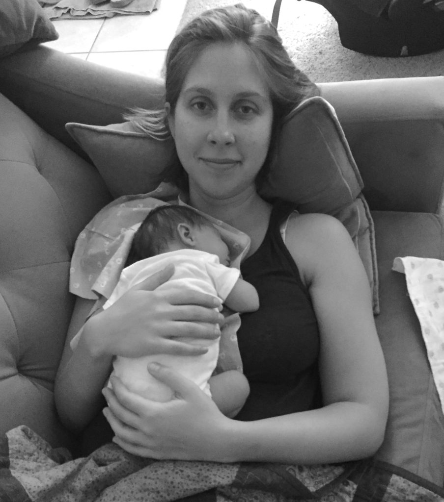 Rachael Svednsen snuggles her newborn - Birthful Podcast Postpartum Story